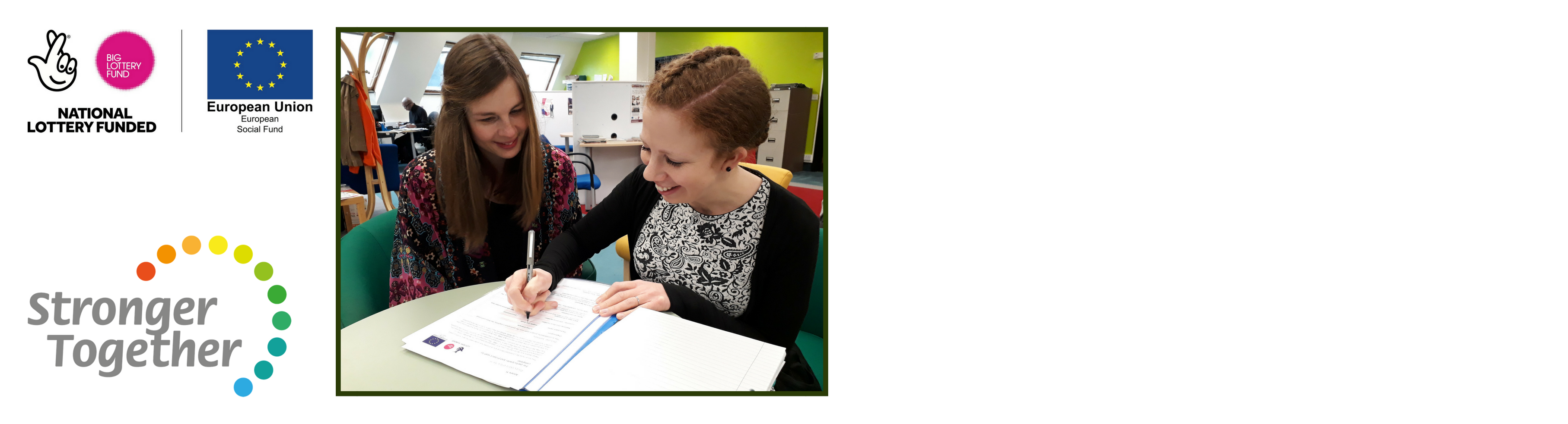 Stronger Together - image of two women completing forms, smiling