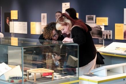 Two people exploring museum exhibit