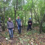 Woodland Improvement Team volunteer stand in cleared area